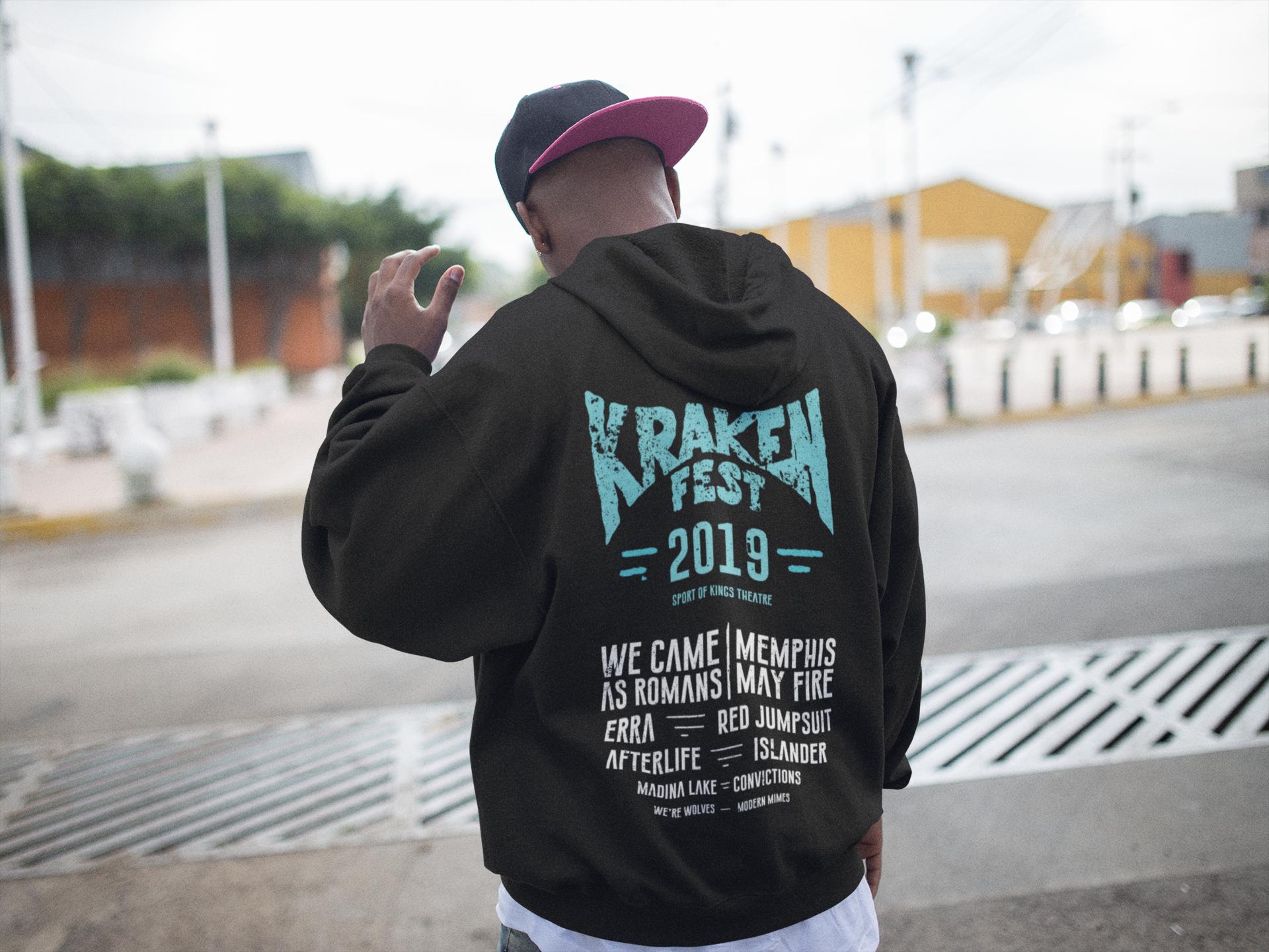 Guy walking away wearing a krakenfest hoodie